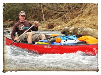 Cameron passing some rapids at the Buffalo river.